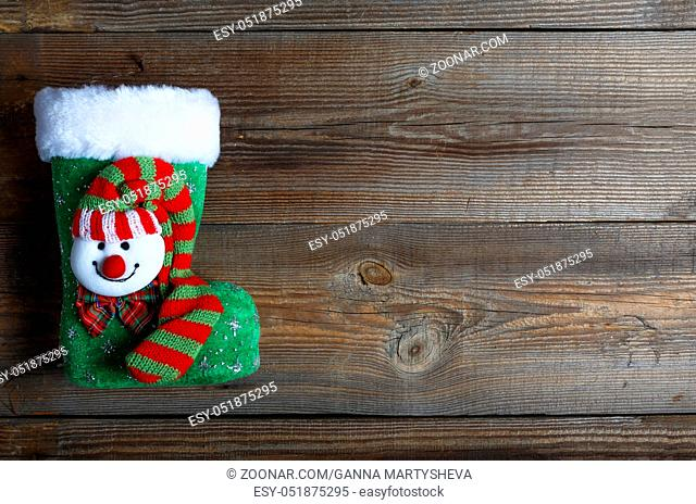 Christmas. Boot of St. Nicholas on the wooden background.festive decor. top veiw
