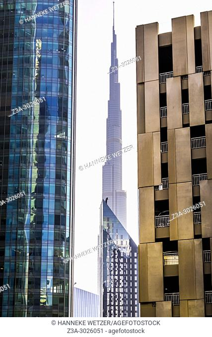 Burj Khalifa seen through modern architecture at the WTC in Dubai, UAE