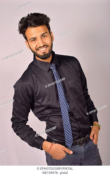 Young male model with black shirt and tie, Pune, Maharashtra