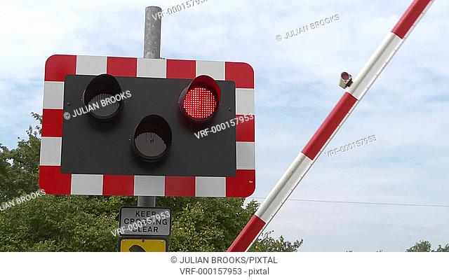 railway safety. red flashing lights and barrier dropping 4:2:2