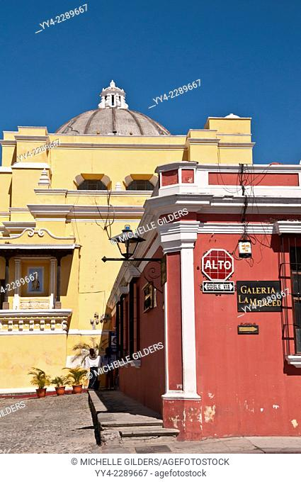 Colorful street corner, with La Merced Church in the background, Antigua, Guatemala