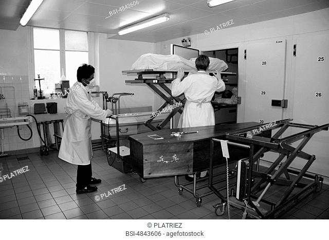Photo essay from Pitié-Salpêtrière Hospital, Paris 75, France. Removal of the deceased of the low-temperature chamber for the presentation to the family