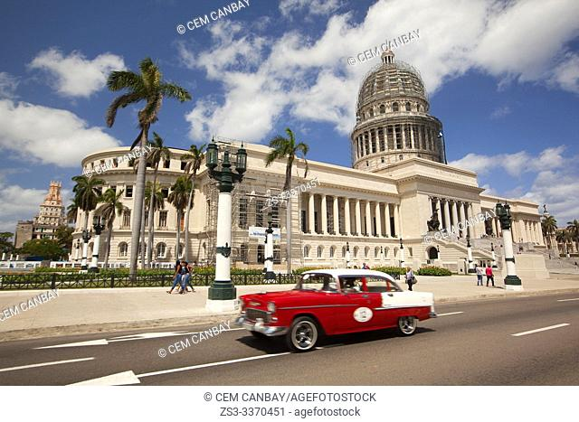 Old American car used as taxi in front of the Capitolio building in Central Havana, La Habana, Cuba, West Indies, Central America