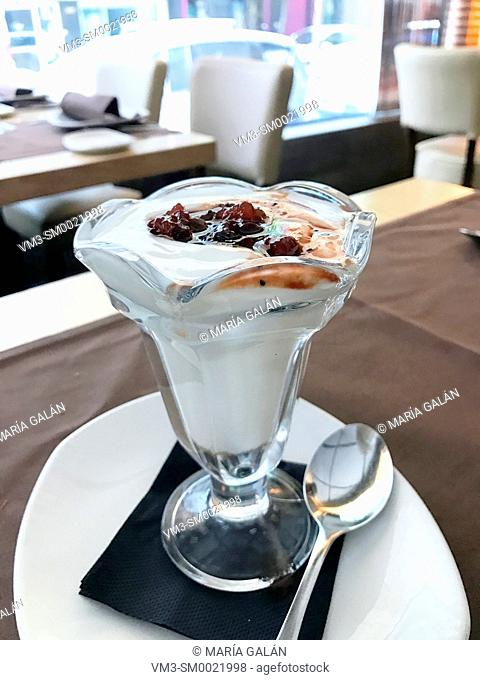 Glass of creamy dessert in a restaurant