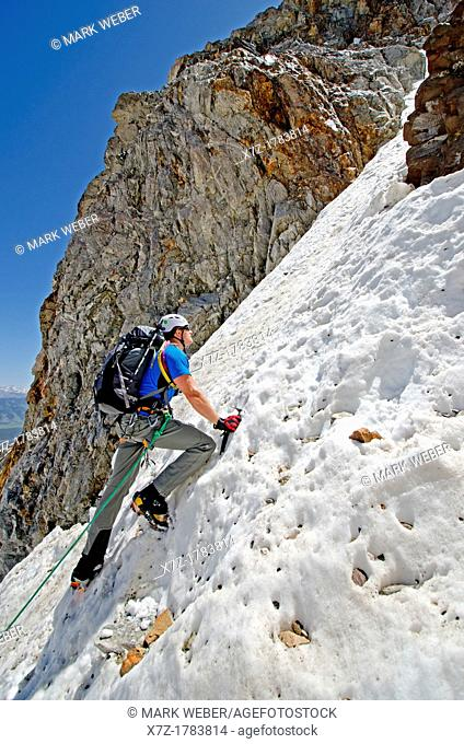 climbing The June Couloir on the North Face of Williams Peak high above the Sawtooth Valley in the Sawtooth Mountains near the town of Stanley in central Idaho
