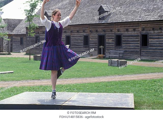 dancing, Thunder Bay, Canada, Ontario, Girl dressed in authentic costume celebrate Scottish Days by doing the Highland Dance at the Main Square at Old Fort...