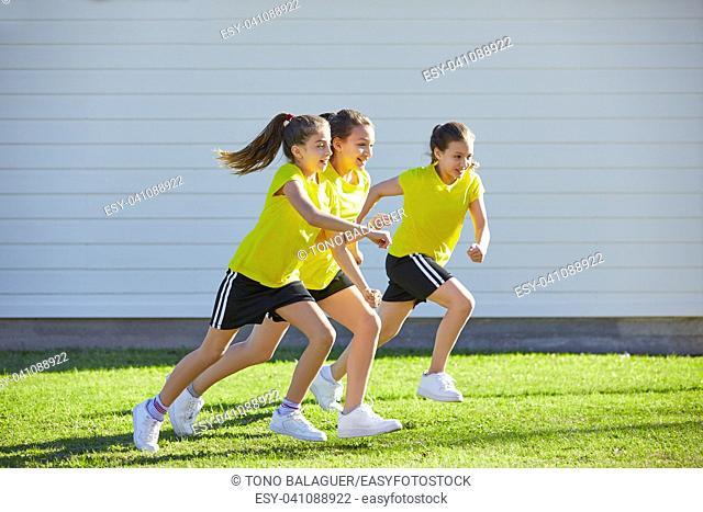 Teen girls group running workout at park outdoor