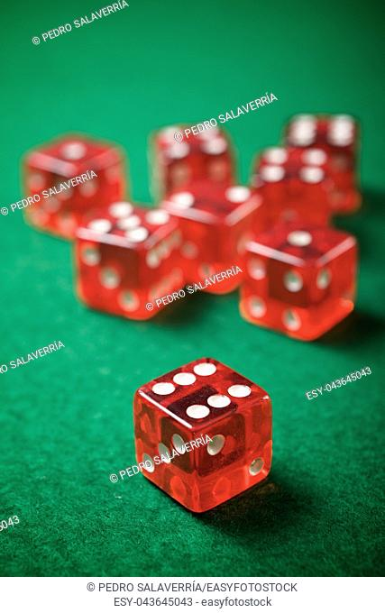casino dices on a green felt