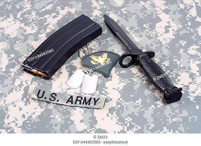 KIEV, UKRAINE - February 6, 2016. M-16 magazine with ammo on camouflage US Army uniform