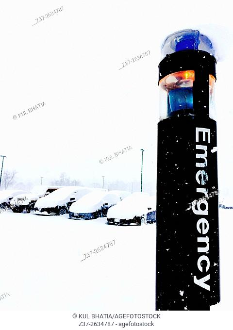 Emergency Post in a snow covered parking lot, Ontario, Canada
