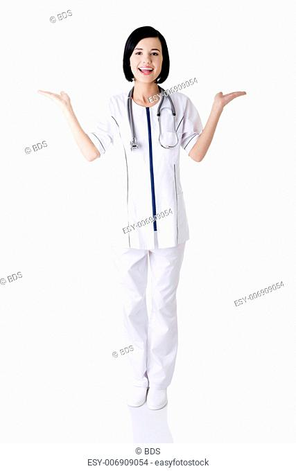 Young medical doctor woman presenting and showing copy space for product or text