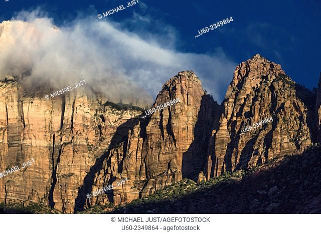 The morning sun shines on West Temple at Zion National Park, Utah