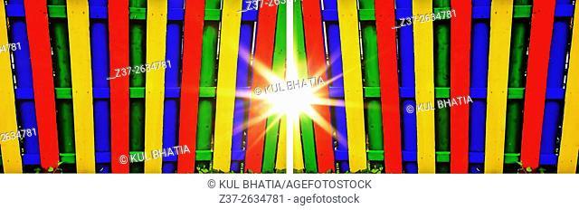 Sun shines through wide, colourful, gates, Montreal, Canada