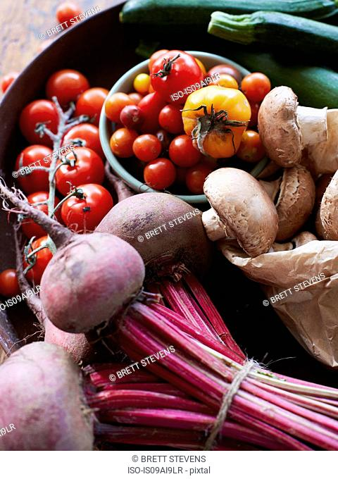 Still life of fresh vegetables and mushrooms with vine tomatoes, beetroot and zucchini