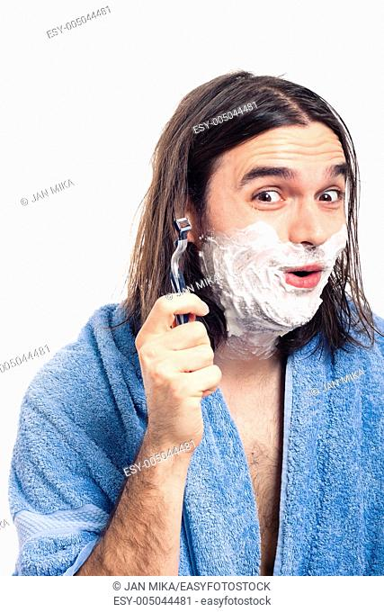 Happy funny longhaired man going to shave after bath, isolated on white background