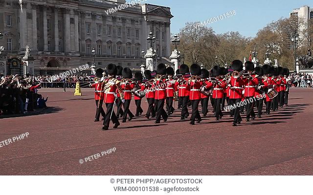 Buckingham Palace in London, with the Grenadier Guards Band marching