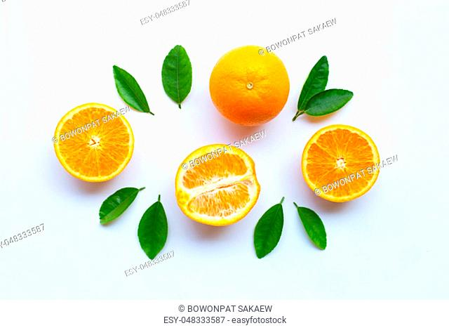 High vitamin C. Fresh orange citrus fruit with leaves isolated on white background