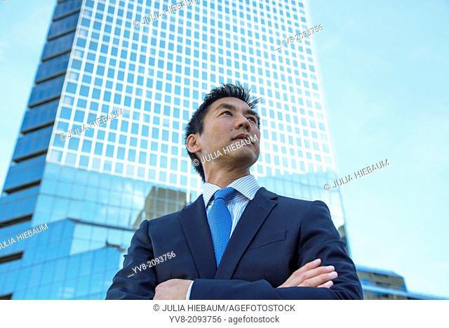 Male executive in front of skyscraper building