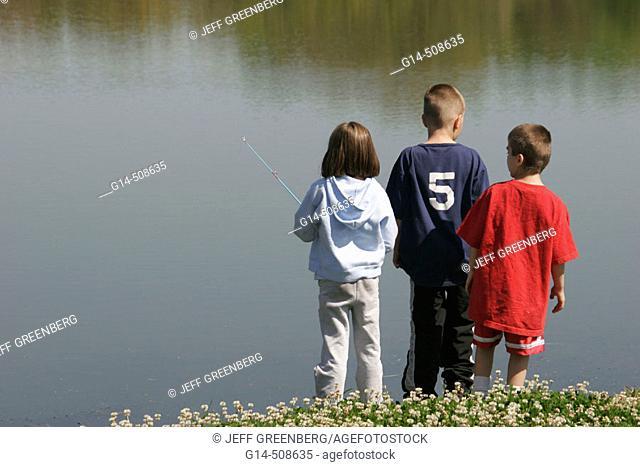 Boys, girl, fishing. Saddle Creek Park. Lakeland. Florida. USA