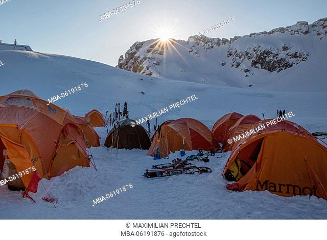 Tents in winter at sunrise