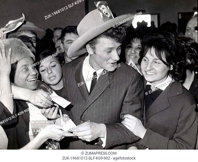 Oct 12, 1968 - Paris, France - JOHNNY HALLYDAY is assaulted by his female admires on his arrival at Orly Airport. Exact date unknown