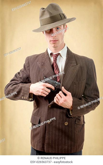 a gangster in a suit vintage, with handgun