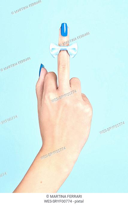 Close-up of bow tie on woman's middle finger