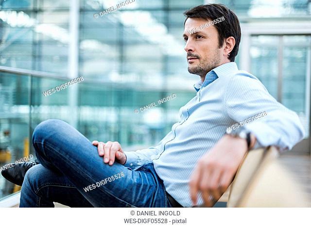 Businessman waiting in airport departure area