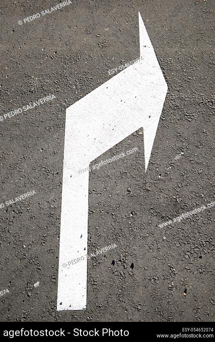 Single arrow directional sign on the floor