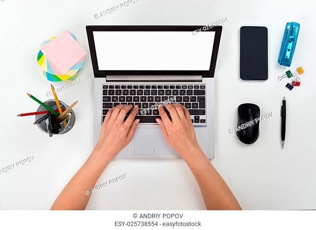 Close-up Of Person Hands Working On Blank Display Laptop