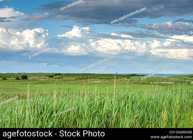 Distant clouds over Cape Cod Canal and Buzzards Bay approaching West Island in Fairhaven, Massachusetts