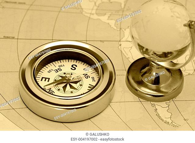 Ancient compass and glass globe