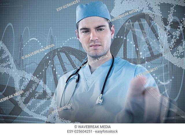 Composite image of surgeon pretending to be using futuristic digital screen