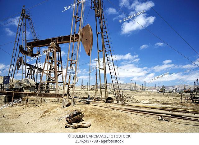 Azerbaijan, Baku, Bibi Heybat, nodding donkey oil pumps pumping oil up from an oil field