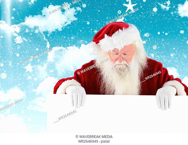Santa claus looking down at white placard