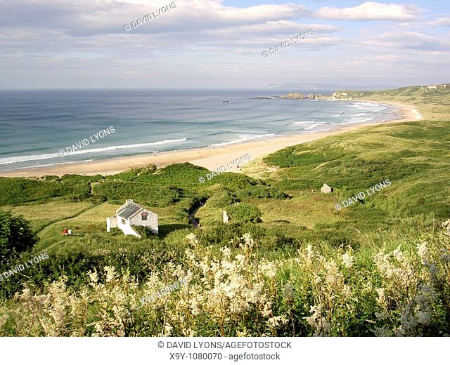 White Park Bay on the Giants Causeway Coast of County Antrim, Northern Ireland  Rathlin Island in distance  Summer