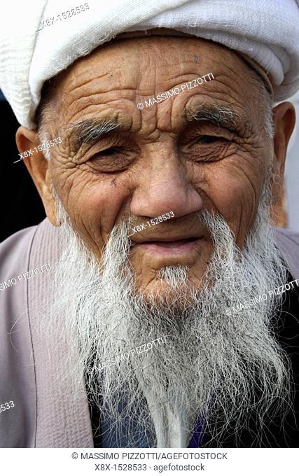 A portrat of an uzbek man with his classic dress, Uzbekistan