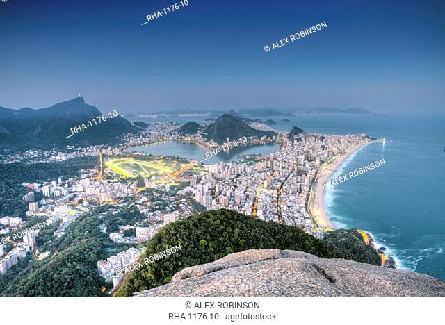View of Ipanema and Leblon beaches, Corcovado and the Sugar Loaf at twilight, Rio de Janeiro, Brazil, South America