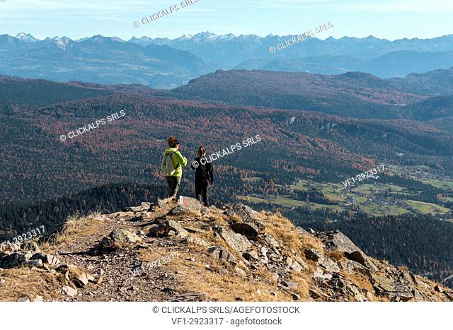 Italy, Trentino Alto Adige, Non valley, two women hikers descend from the top of Luco Mount