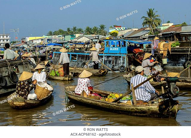 Vendors sell their produce at the floating market in the Mekong Delta region of Southern Vietnam, Socialist Republic of Vietnam. No Model Release