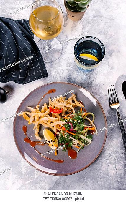 Plate of French fries with salad