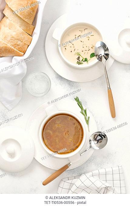Two types of soup with bread