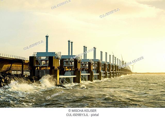 Strong waves crashing on Oosterscheldekering flood barrier, Vrouwenpolder, Zeeland, Netherlands