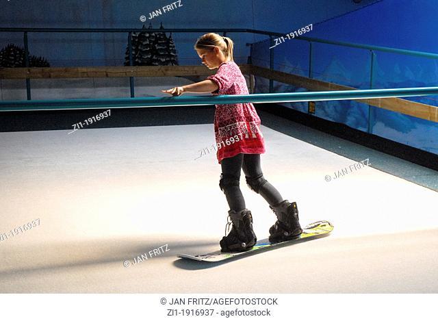 practising snowboarding at rolling carpet