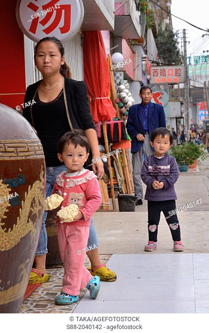 Little Chinese girl on the street