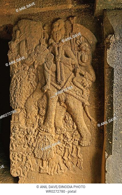 Sculpture carved on wall in Bhaja caves in 2nd century B.C . , Lonavala , Maharashtra , India