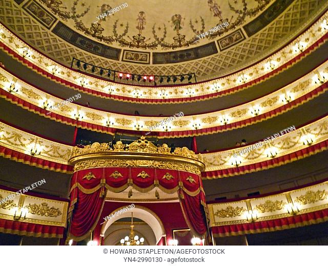 Interior of the Alexandrinsky Theatre in St. Petersburg, Russia. Shown are the balcony levels and part of the building's domed ceiling