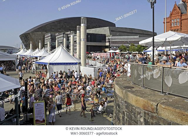 Crowds of people enjoying the sunshine at the Cardiff Bay Food and Drink Festival, Wales UK