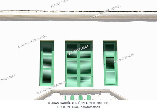 Traditional green window shutters over whitewashed facade, Tangier, Morocco