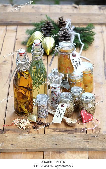Various homemade Christmas gifts: porcini mushroom and thyme salt, tarragon vinegar, porcini oil, orange and cranberry mustard and pumpkin and apple chutney